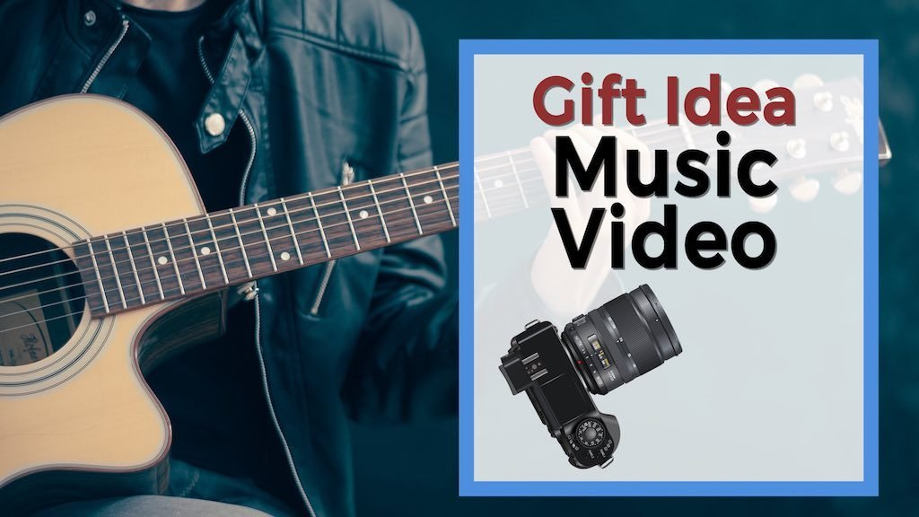 gift idea music video guy holding a guitar