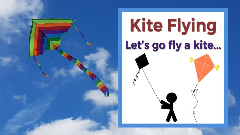 Kite flying, let's go fly a kite. Colorful kite flying in a cloudy blue sky.