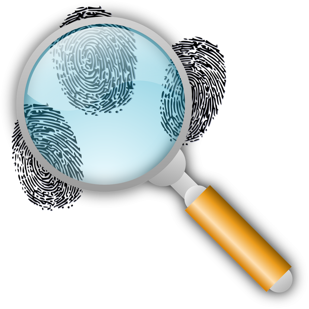 Detective magnifying glass and finger prints.