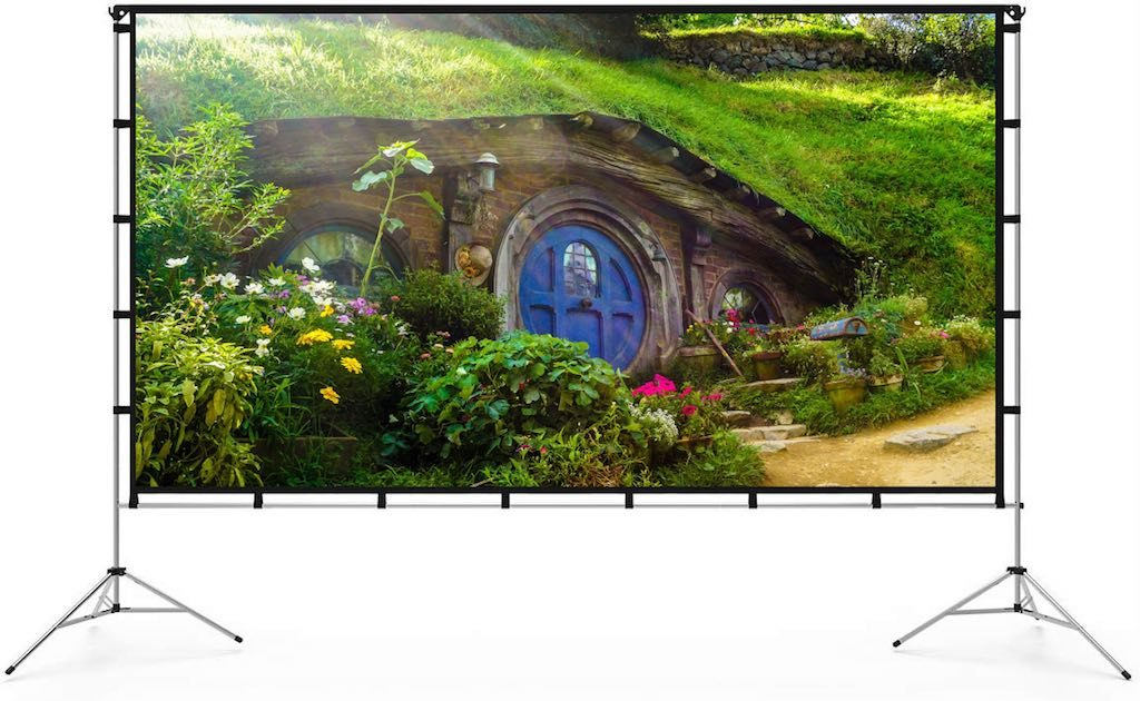 Portable movie screen with two tripods and screen. With Hobbiton on the screen.