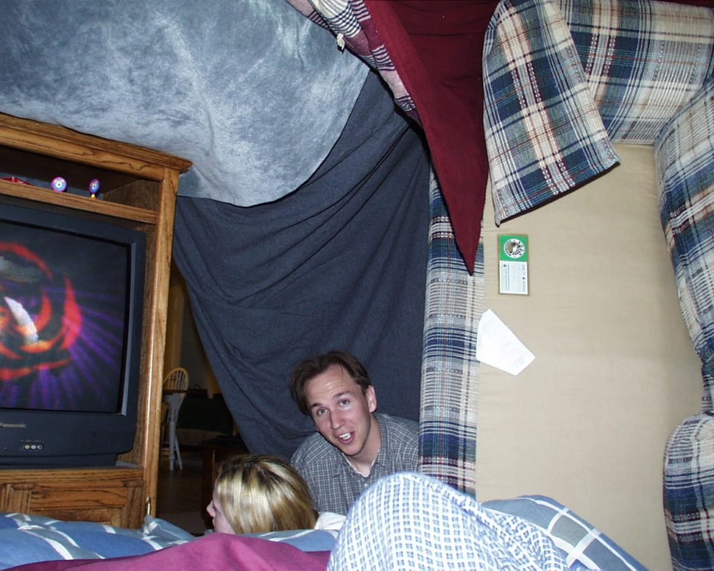 Guy and girl inside a for watching a movie.