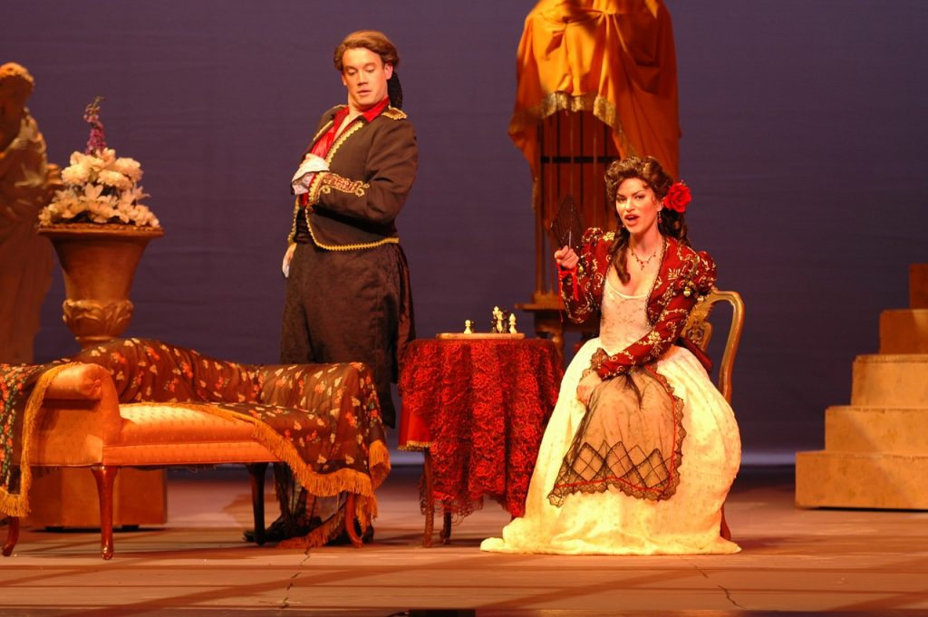 Barber of seville opera with a man and woman on stage singing.