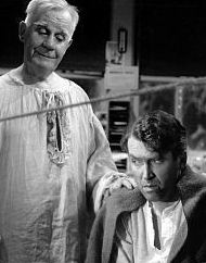 Guardian Angel Clarence visiting George Bailey in It's a Wonderful Life