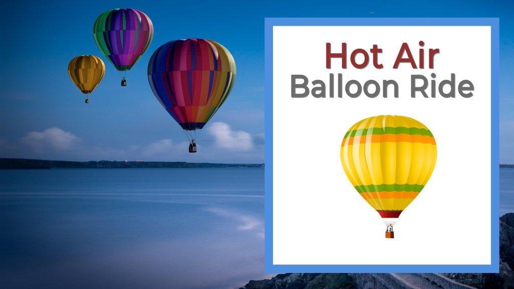 Hot air balloon ride 3 balloons flying over the ocean