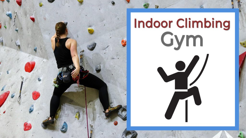 Indoor climbing gym girl climbing on a rock wall for her perfect first date idea