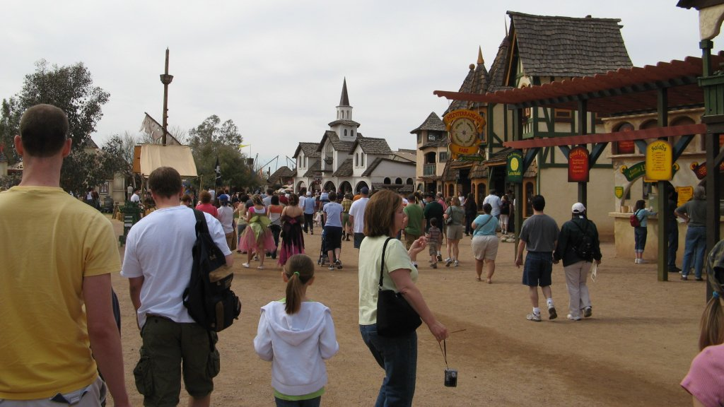 A bunch of people walking around at the Renaissance festival