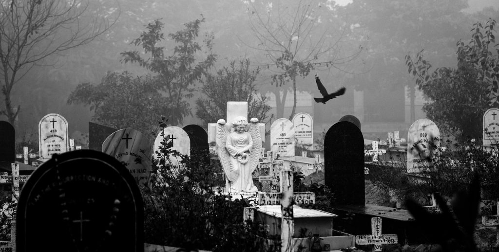 Graveyard with many headstones