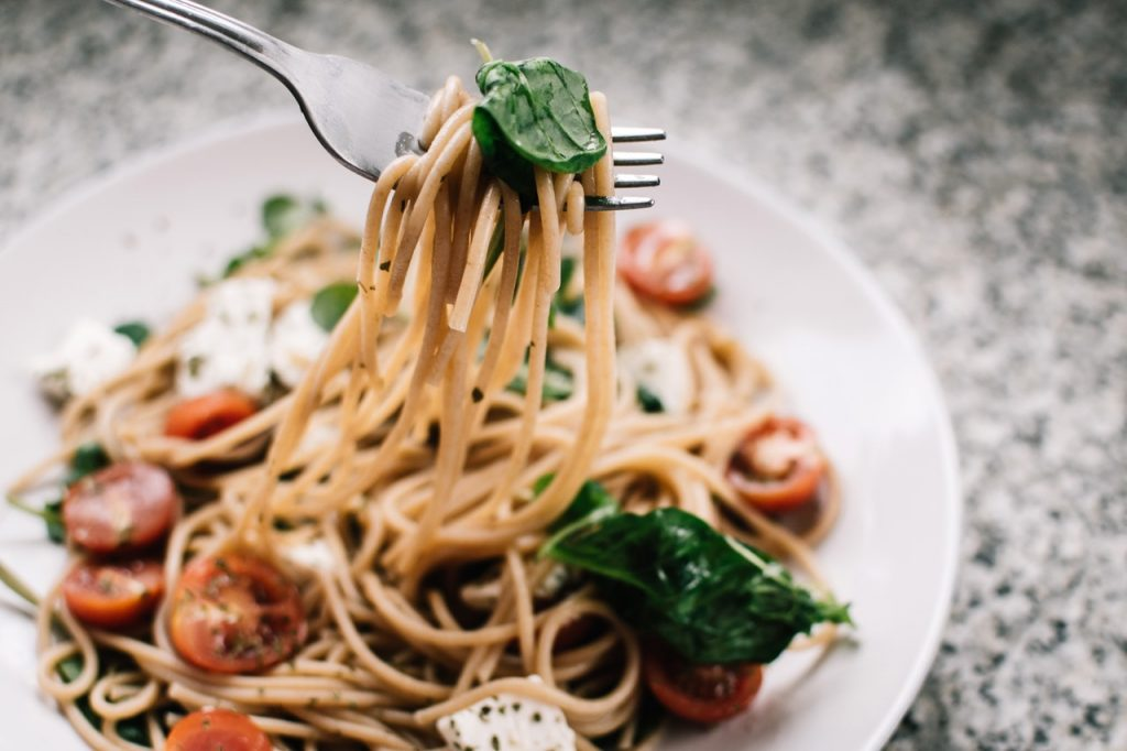 pasta dinner dish with basil and tomatoes