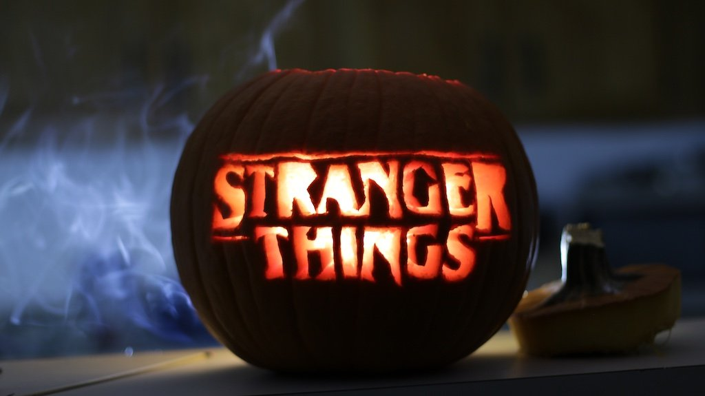 Stranger Things carved pumpkin on a counter top
