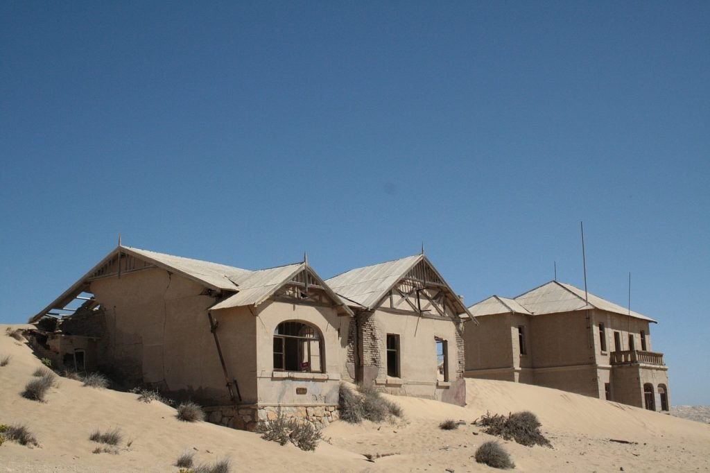 abandoned ghost town in the sand