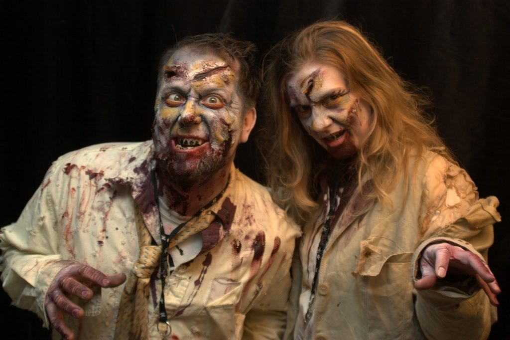 Man and woman dressed as zombies for a costume party