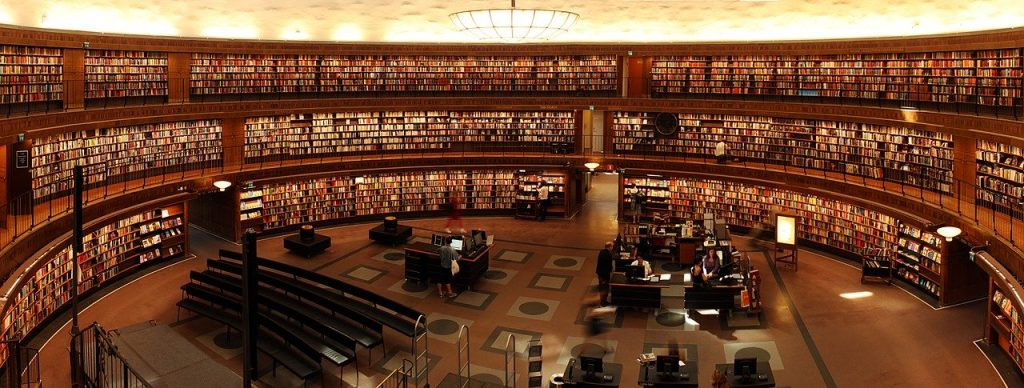 Beautiful library with people sitting at desks