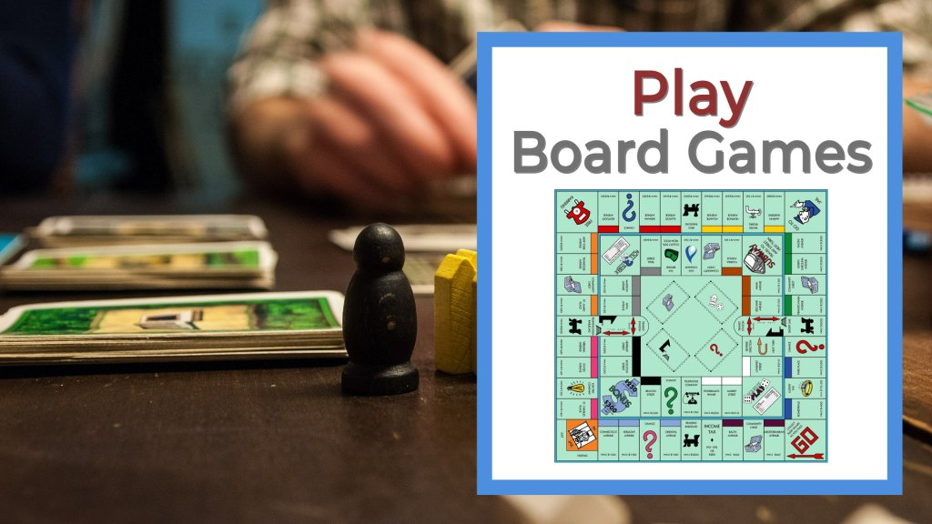Play board games group date idea people playing games on wooden table.