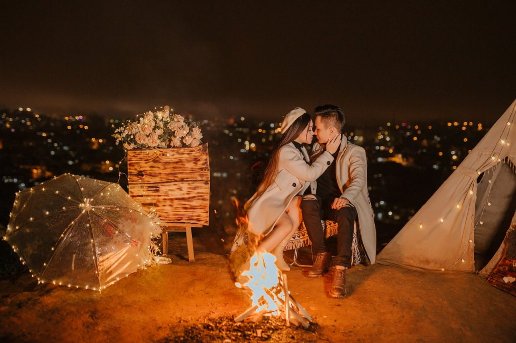 Couple on a romantic date with a fire.