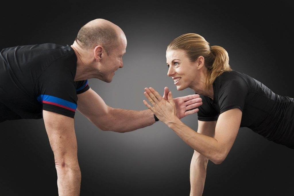 Man and woman working out at a gym