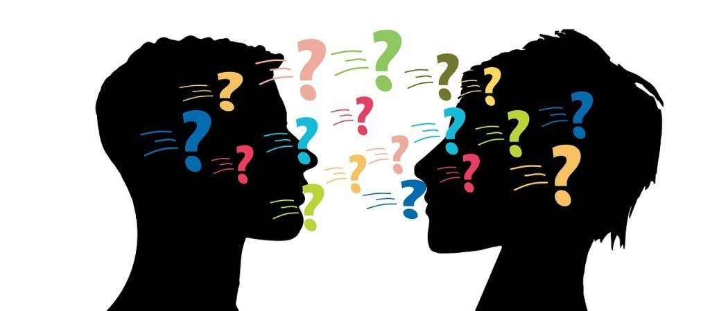Man and woman asking questions