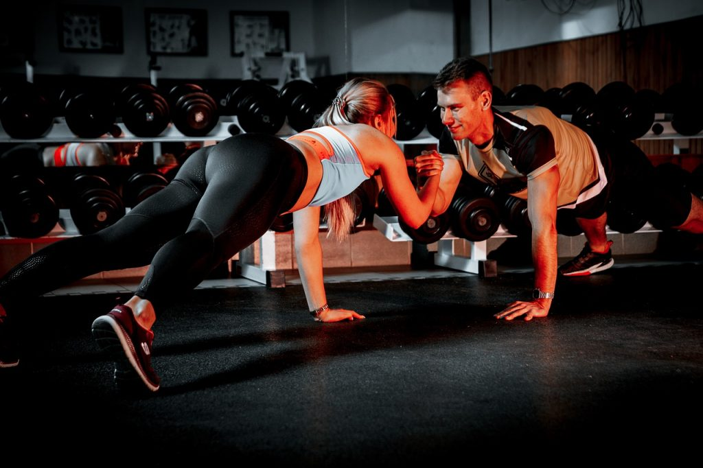 Man and woman working out at the gym