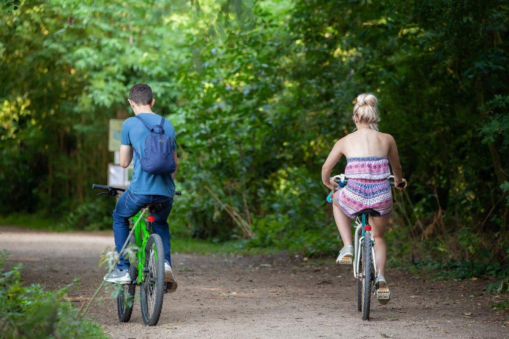 Couple on bikes during their romantic getaway weekend.