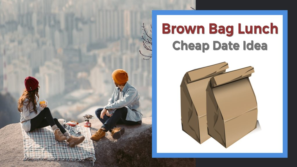 couple sharing a brown bag lunch on top of a mountain