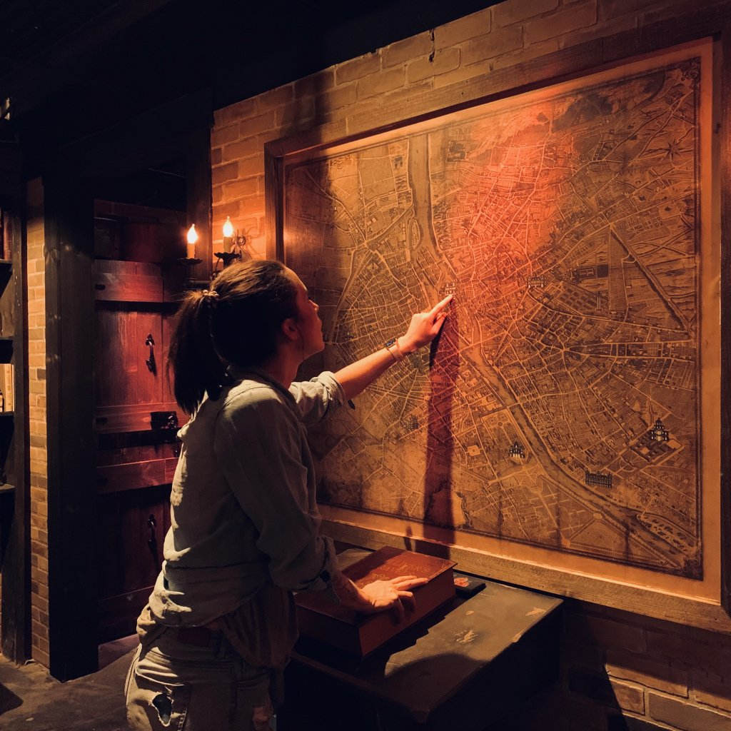 Girl pointing at a map in an escape room