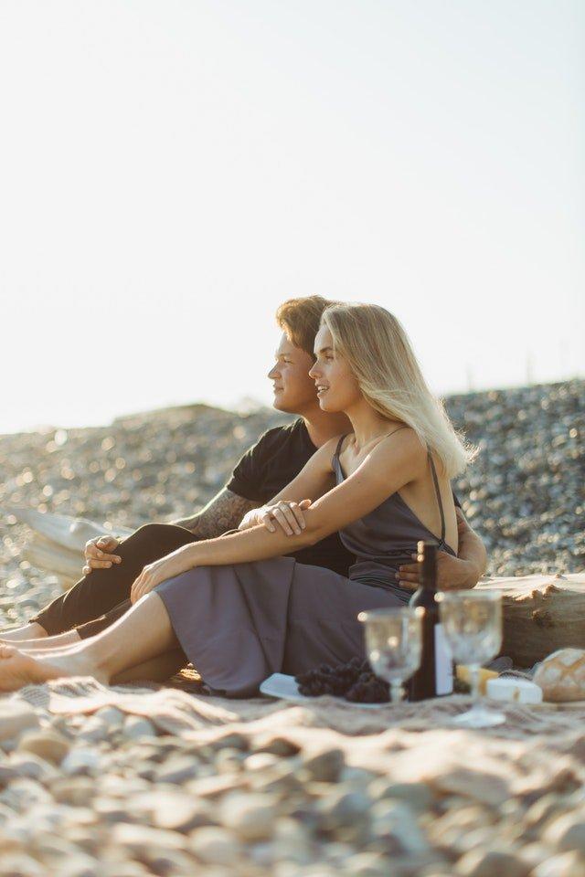 Couple having a picnic on a beach.