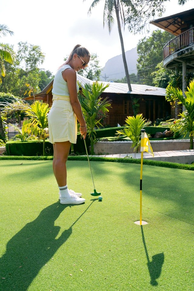 Girl at a miniature golf location.
