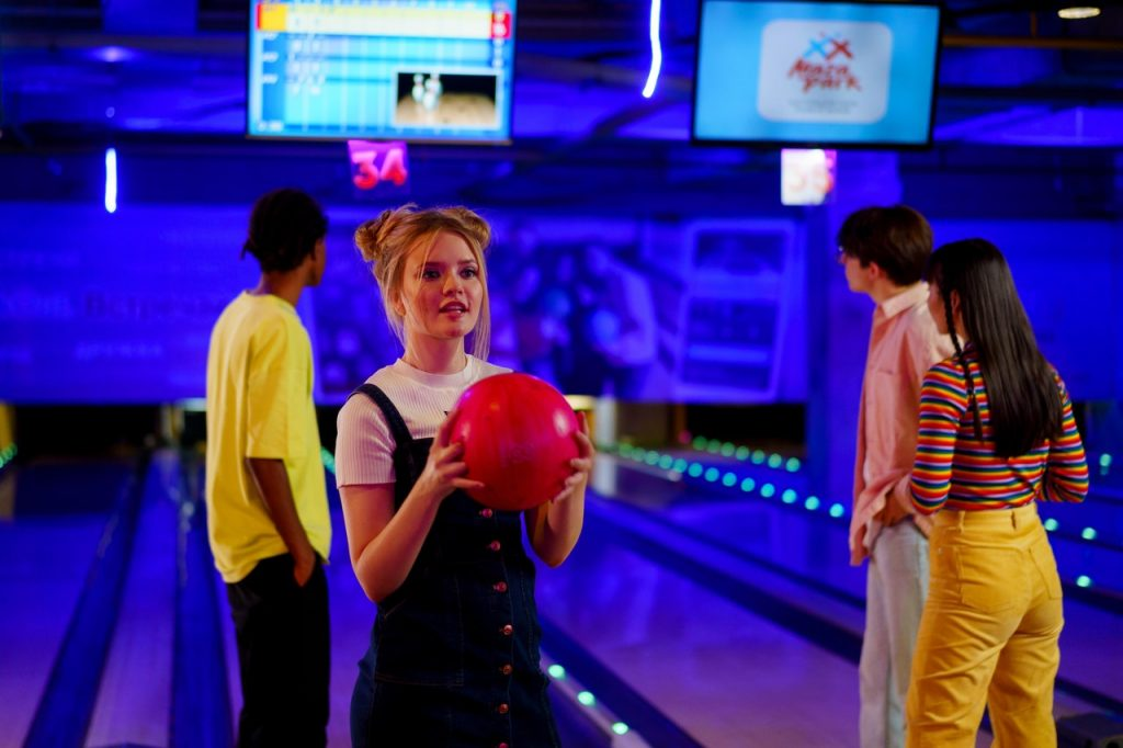Two couples on a group date and bowling alley