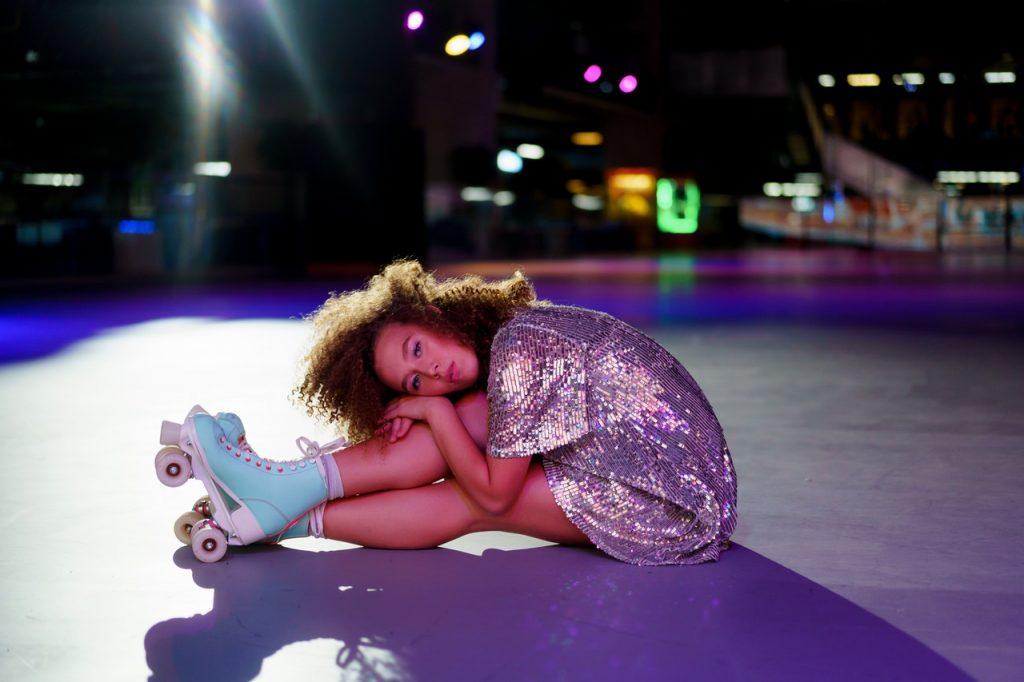 Girl dressed up for a roller disco skating rink